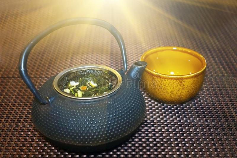 Tea set in Japan. Traditional Japanese herbal tea recipe made in cast iron teapot with organic dry herbs. royalty free stock images