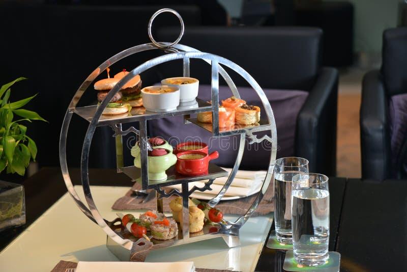 Tea set platter. Deluxe afternoon tea sea platter royalty free stock images