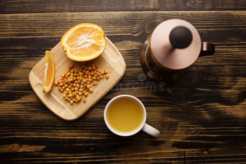 Tea set of tea pot and cup with orange stock photography