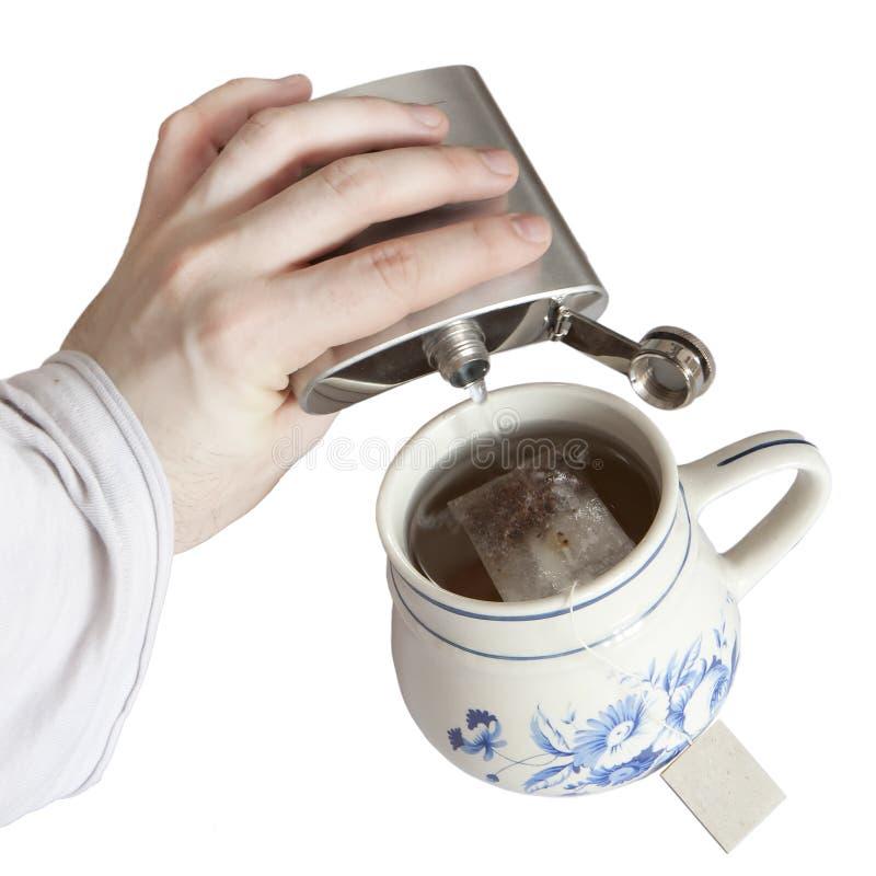 Tea with slivovitz. Making tea with slivovitz - isolated royalty free stock image