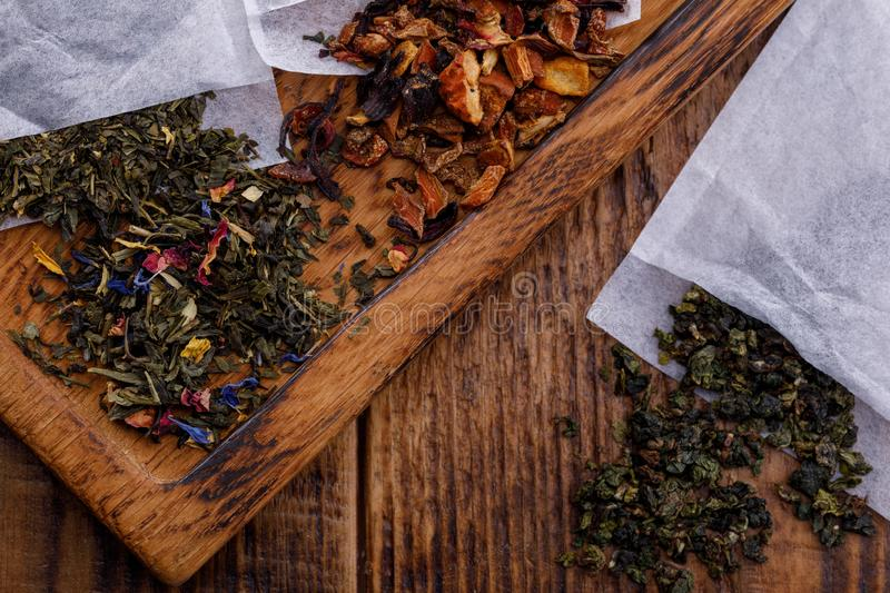 Tea specialized packages for brewing on a wooden board. Tea of different varieties. Tie Guan fruit herbal tea royalty free stock images