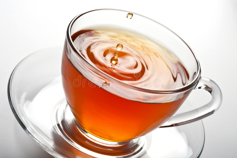 Download Tea splash in glass cup stock photo. Image of black, pour - 8659684