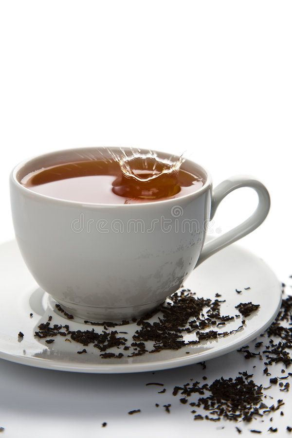 Tea Splash In White Cup Isolated Stock Photo