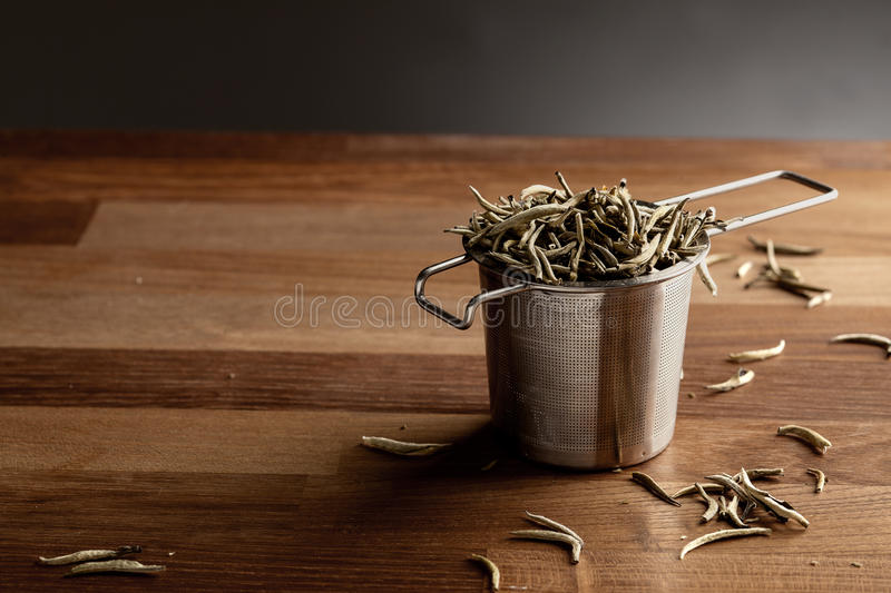 Tea strainer and loose tea stock photography