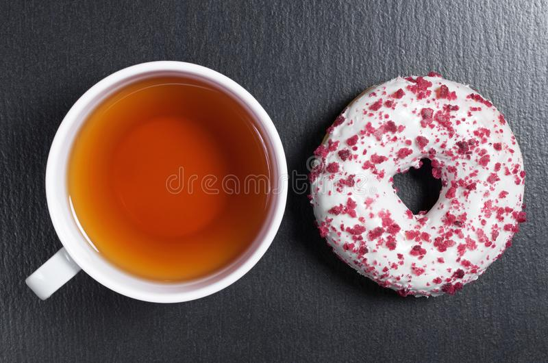 Tea and sweet donut royalty free stock image