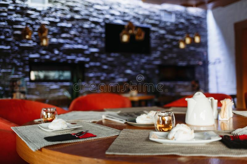 Tea table on the background of a purple wall royalty free stock images