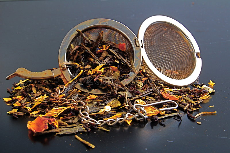 Tea with tea infuser stock image