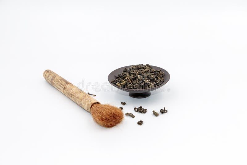 Tea and tea saucer pen stock photography