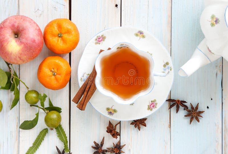 Tea time. Herbal tea with fruit in porcelain english tea set stock image
