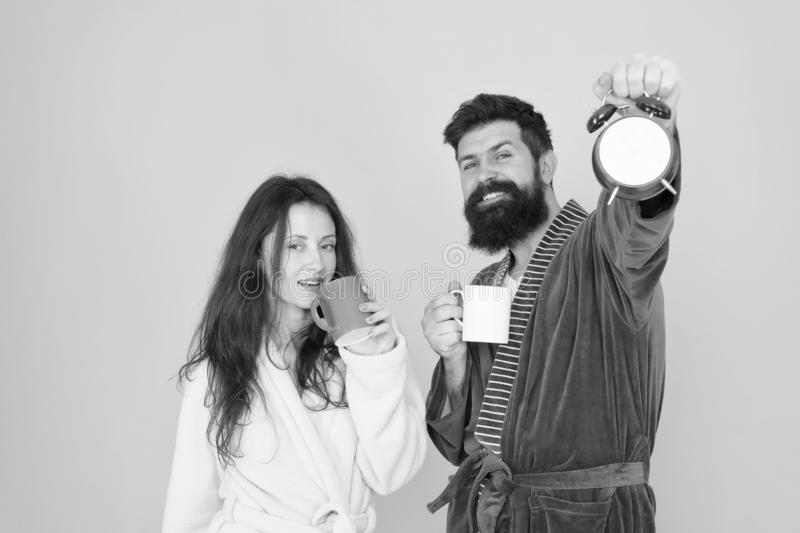 Tea time at home. hard morning. morning couple drink coffee. Wife and husband bathrobe. bearded man and girl coffee cup royalty free stock image