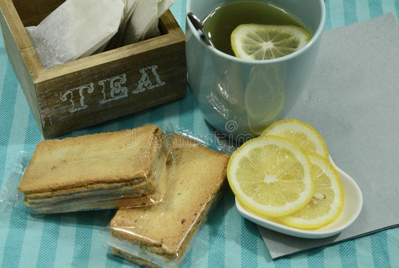 Tea time. Lemon with freh and hot tea stock photography