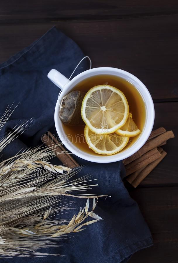 Tea time with lemons and cinnamon royalty free stock photos