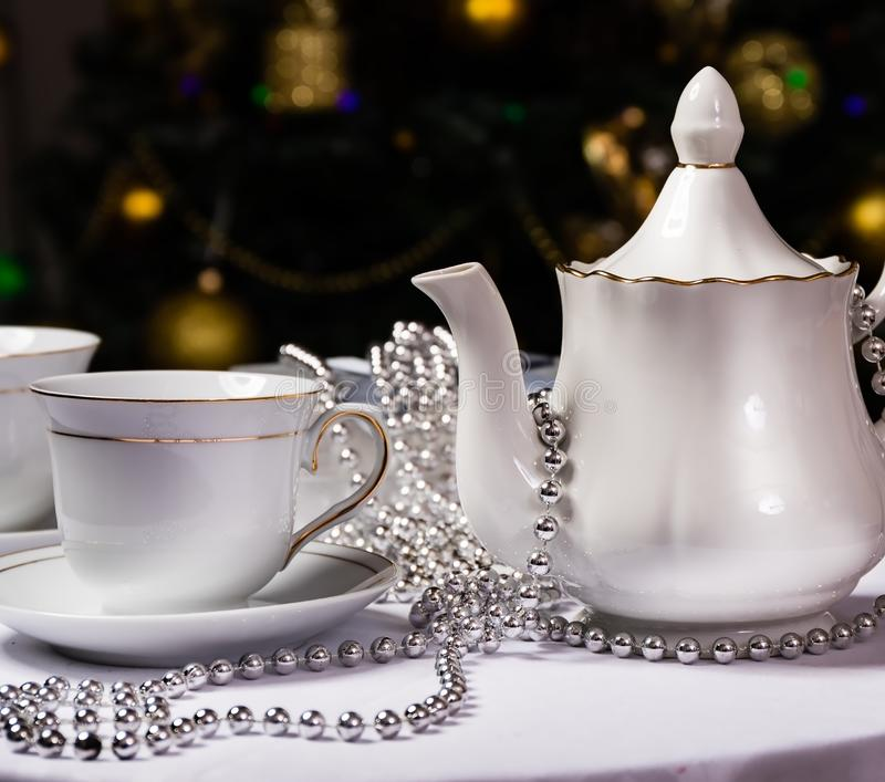 Tea time, white teapot and cups on the table. stock image