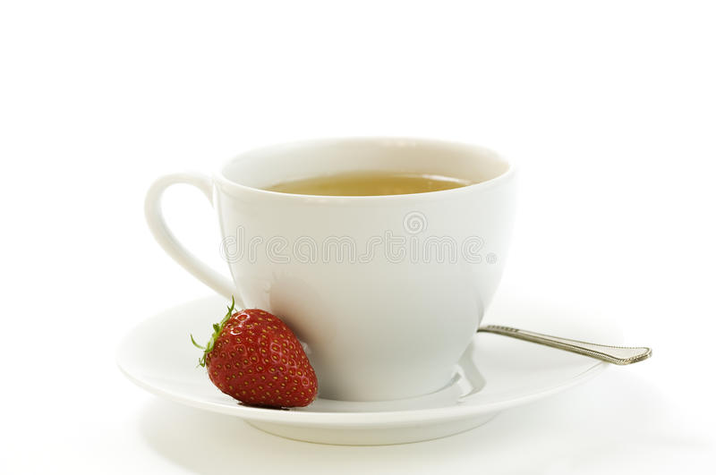 Tea time whith strawberry royalty free stock image