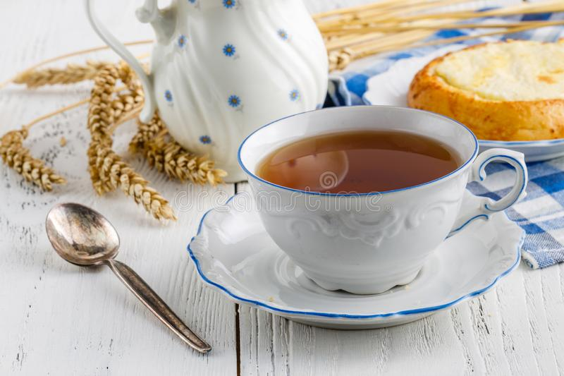 Tea time at wooden table indoor stock image