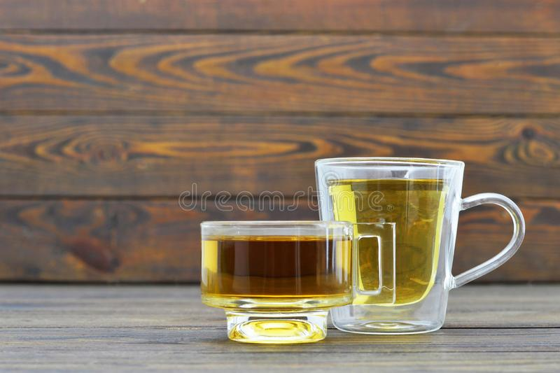 Tea in transparent cups. On wooden background royalty free stock images