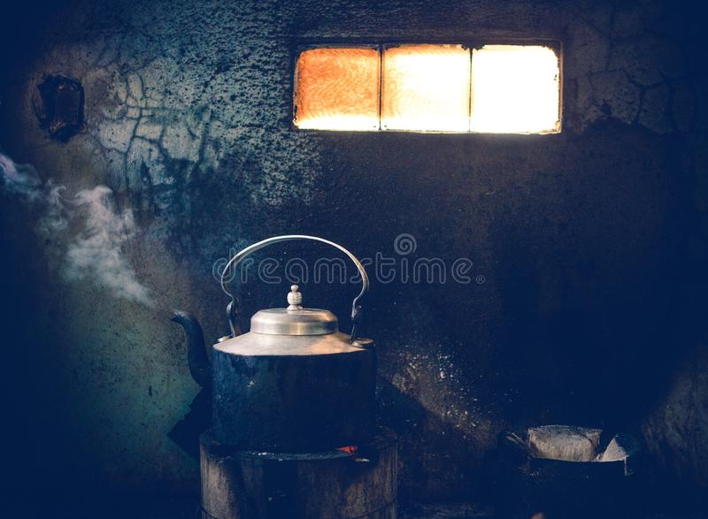 Tea being boiled at roadside restaurant in India stock images