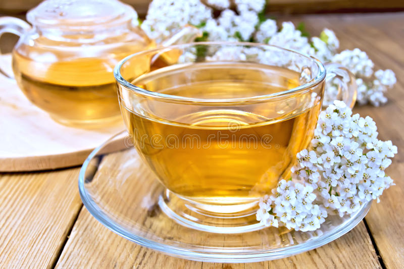 Tea with yarrow in cup on board royalty free stock photos