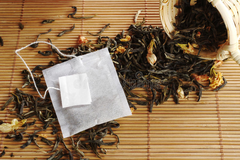 Teabag with Label on Green Tea royalty free stock image