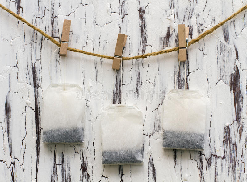 Teabags on clothespins stock photography