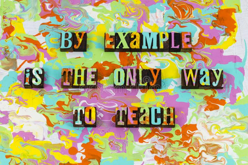 Teach example leadership inspiration motivate. Letterpress typography quote teaching lead leader inspire motivation business plan communication education school stock image
