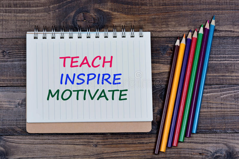 Teach Inspire Motivate on notebook stock images