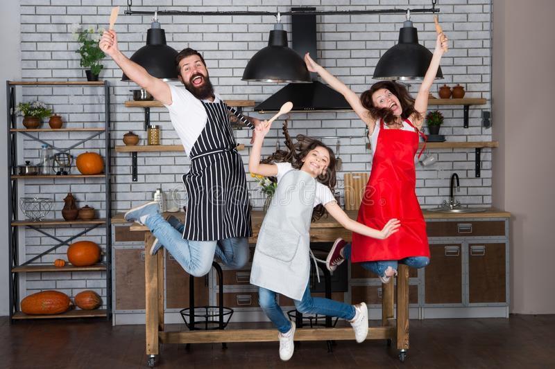 Teach kid cooking food. Weekend breakfast. Cooking with child might be fun. Having fun in kitchen. Family mom dad and stock images