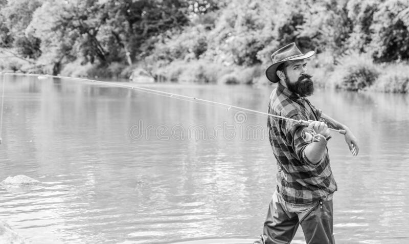 Teach man to fish. Patience and waiting. Fly fishing may well be considered most beautiful of all rural sports. Fisherman catching fish. Fishing outdoor sport royalty free stock images