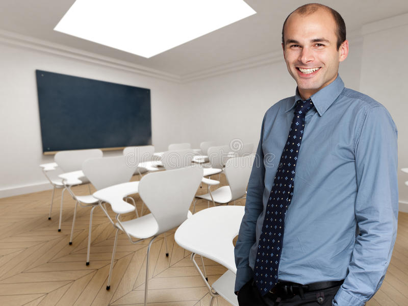 Teacher. Young teacher smartly dressed in an empty classroom
