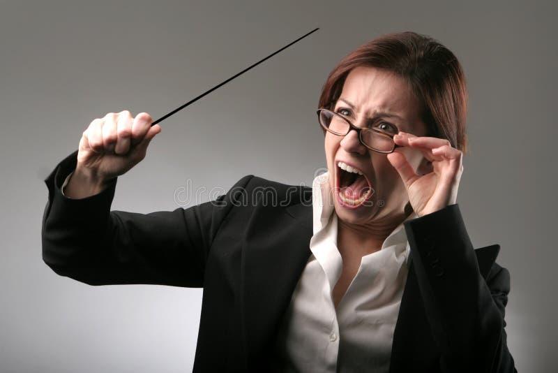 Teacher 56. A portrait of bad teacher with a stick stock image