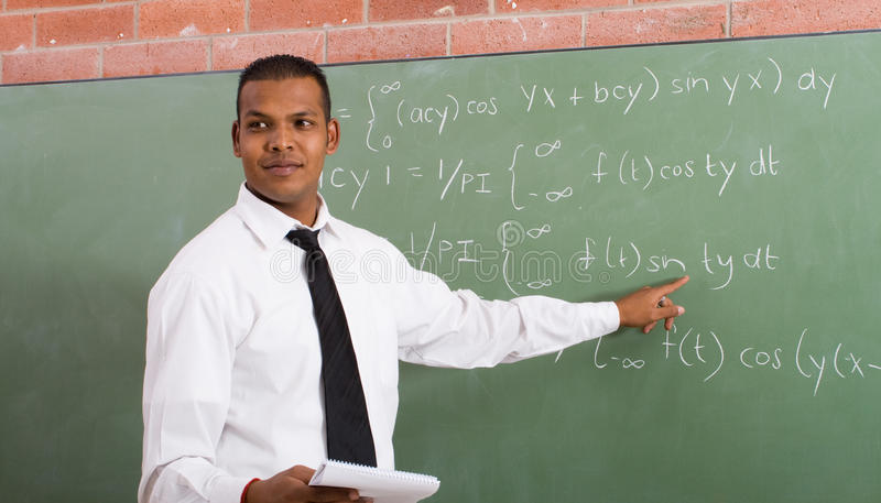 Download Teacher stock photo. Image of chalkboard, pointing, community - 9707054
