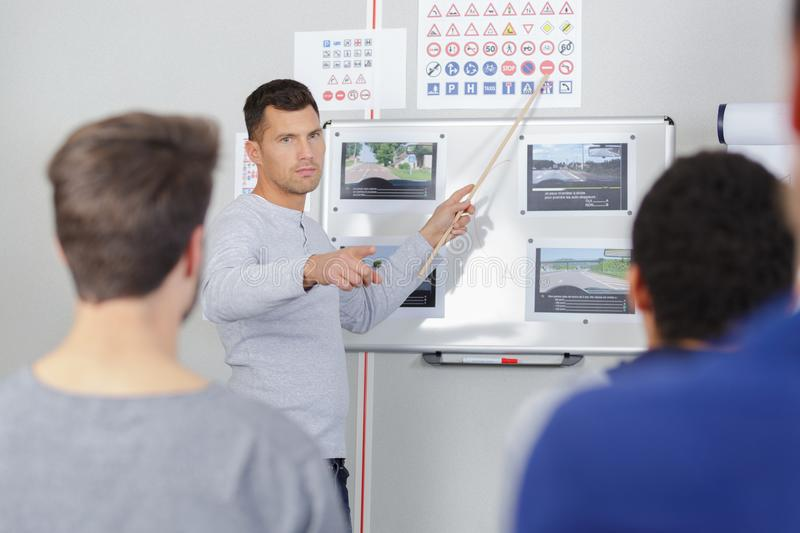 Teacher asking question in highway code lesson royalty free stock photo