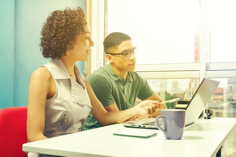 Teacher is assisting student in studies. royalty free stock photo