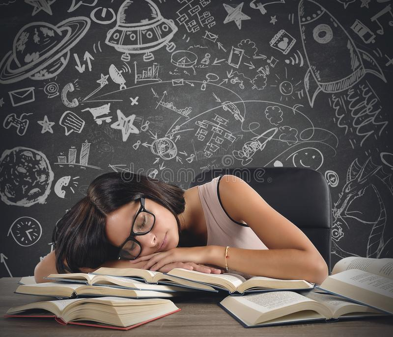 Teacher of astronomy. A teacher of astronomy sleeping over books royalty free stock images