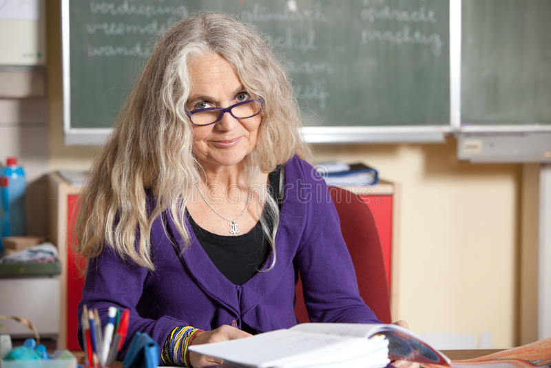 Teacher Behind Her Desk Stock Image