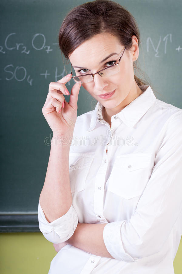 Teacher during chemistry lesson royalty free stock images