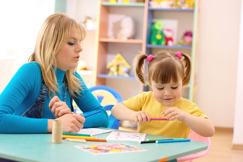 Teacher with child in preschool royalty free stock photography