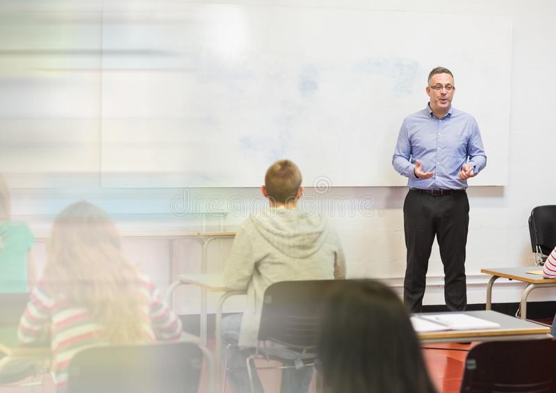 Teacher with class. Digital composite of teacher with class stock image