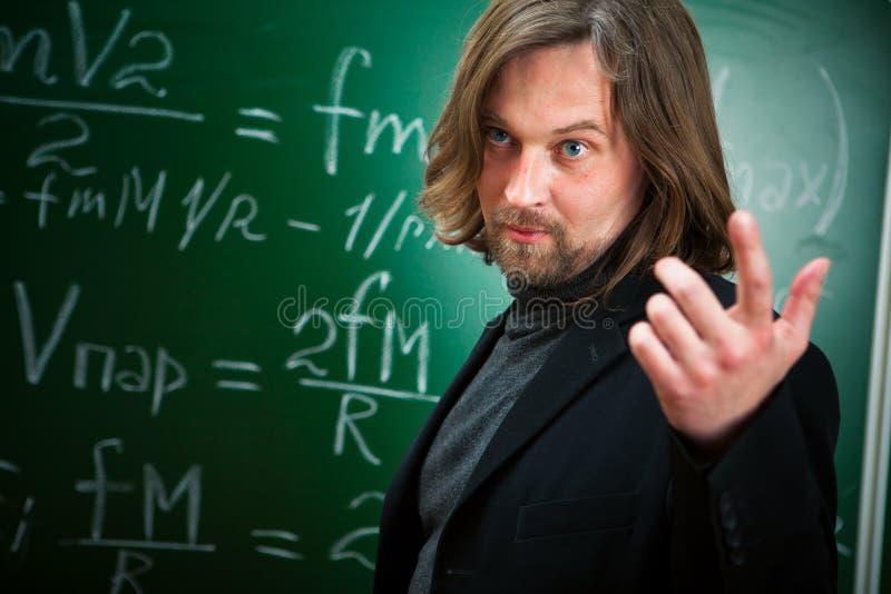 Teacher in the classroom stock photo