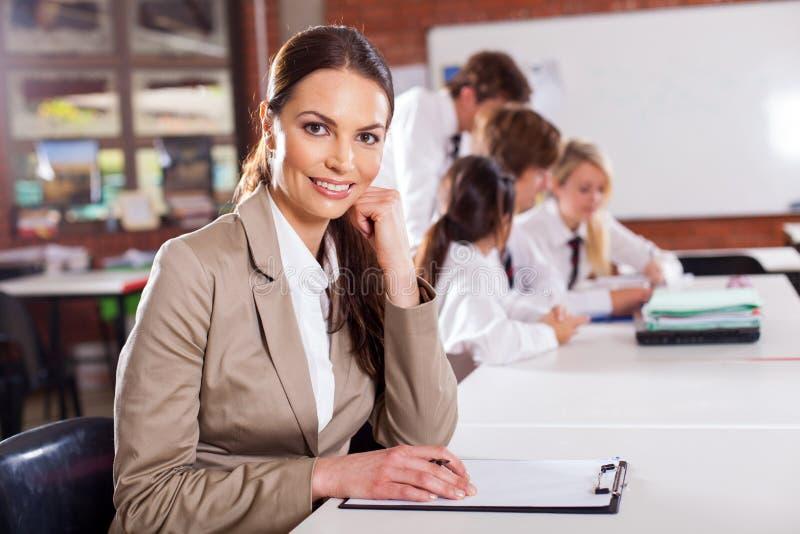 Teacher in classroom stock photos