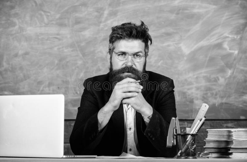 Teacher concentrated bearded mature schoolmaster listening with attention. Pay attention to details. Teacher listening. Answer or report. Teacher formal wear royalty free stock photo