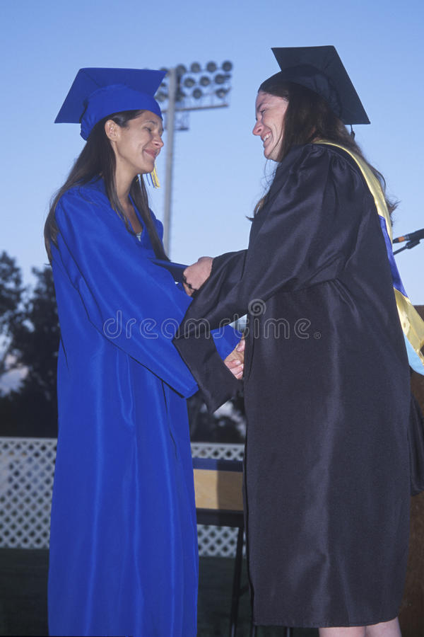 Download Teacher Congratulates A High School Graduate Editorial Stock Image - Image of female, states: 25965789