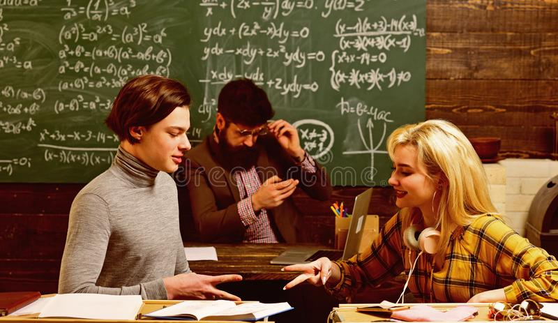 Teacher conveys sense of leadership to students. Teenage female student preparing for exams at college classroom stock image