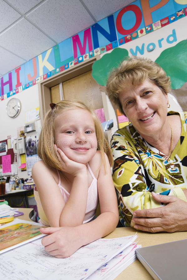 Teacher With Elementary Student stock photography