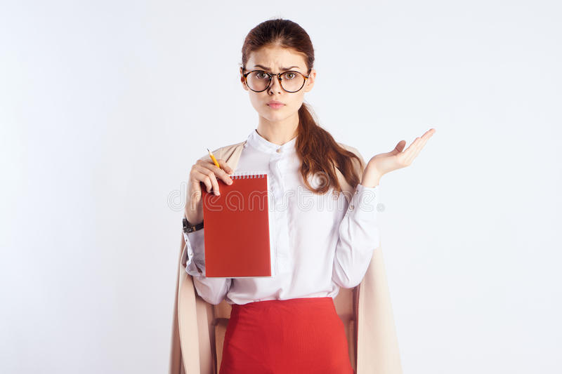 Teacher, empty space for copying, red notebook stock images