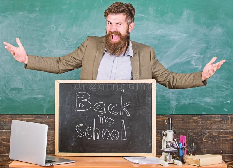 Teacher experienced educator welcomes new enrollees to begin study and get education. Celebrate day of knowledge. Welcome back to school. Teacher or educator stock image
