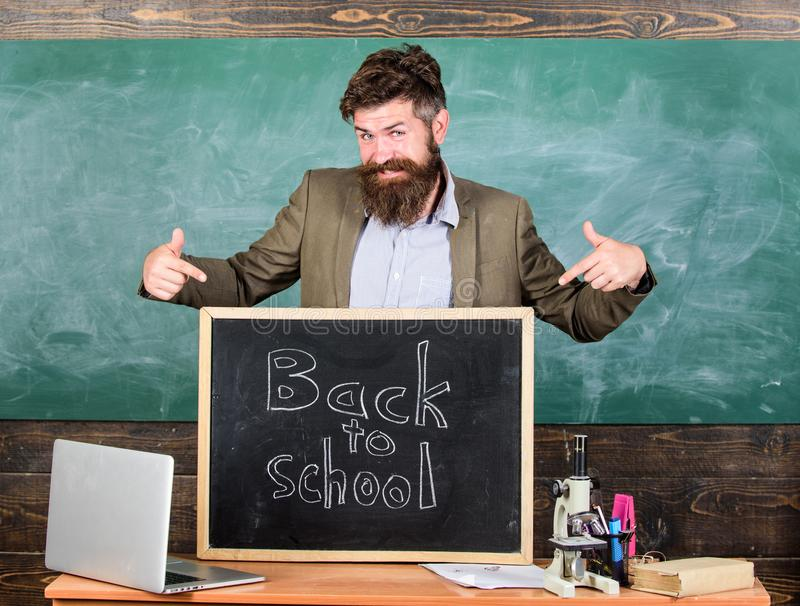 Teacher experienced educator welcomes new enrollees to begin study and get education. Welcome back to school. Teacher or stock photography