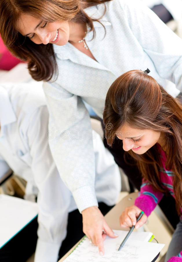 Download Teacher Explaining To A Female Student Stock Image - Image of smile, female: 25466201