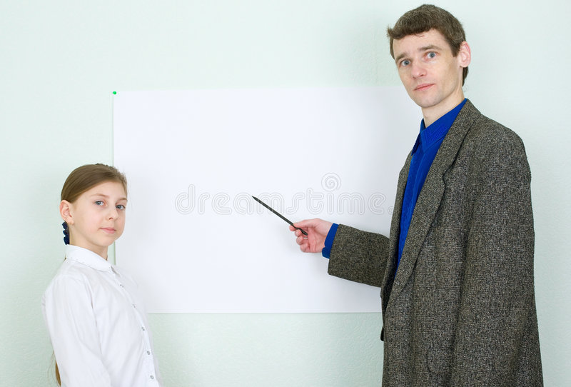 Download Teacher Explains Something To The Schoolgirl Stock Images - Image: 9154944