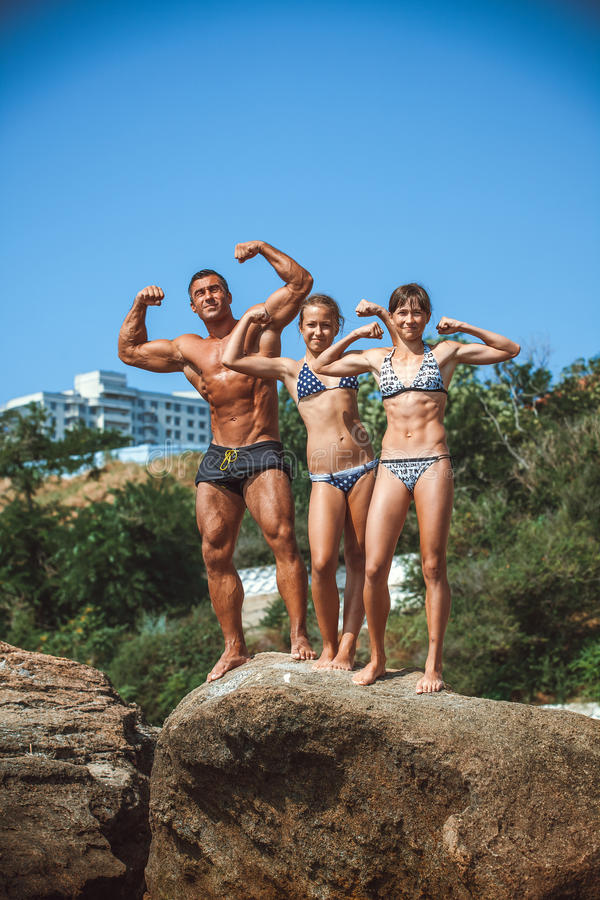 Teacher on fitness with the pupils on a beach stock images